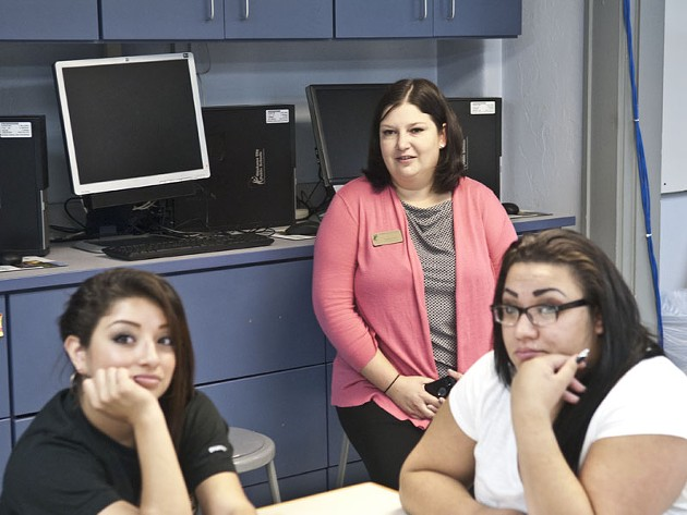 Aurora Lora on a visit to Emerson Alternative School and the Family Consumer Science classroom with students Victoria Ramirez, left, and Esmeralda Perez listening to instruction.  mh