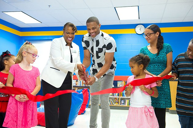 From left, Nevaeh, Lillian, principal Mrs.A.L. Jones, Russell Westbrook, Simone, Olivia and Christian. - Ribbon cutting for Russell's Reading Room.Photo/Shannon Cornman - SHANNON CORNMAN