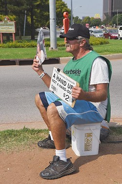 Calvin McCraw most days can be found selling the Curbside Chronicle from the median on N. Classen Boulivard at the intersection of N.W Expressway, 9-30-15. - MARK HANCOCK