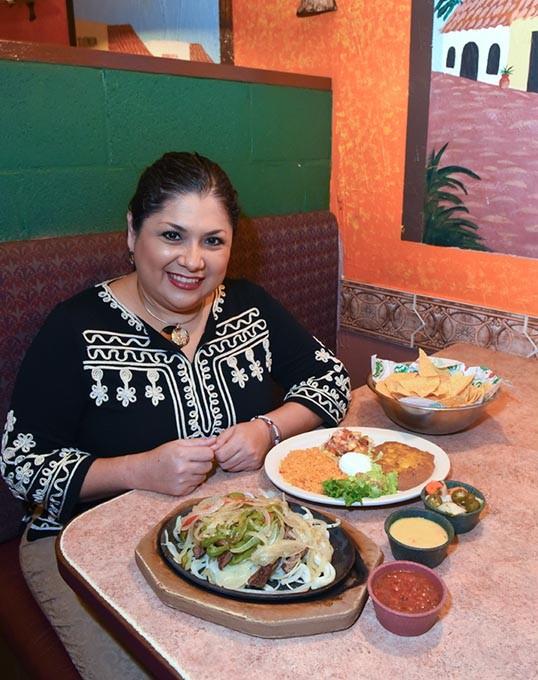 Sandra Rios is the owner of Carlito's Cafe in Yukon, shown with fajitas, 11-9-15. - MARK HANCOCK