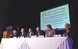 From left, Norman Mayor Cindy Rosenthal speaking, State Representitive Scott Inman, Chuck Hoskin Jr., Cherokee Nation, Dr. Mickey Hepner, UCO, State Senator Clark Jolley, and State Auditor Gary Jones, during the Annual State Budget Summit held at the Will Rogers Center, 1-28-16. - MARK HANCOCK