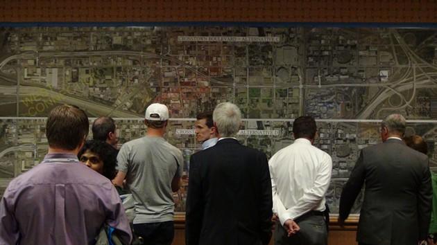 Residents mull proposed Crosstown Boulevard plans in last week's public meeting. Photo by Ben Felder. - BEN FELDER