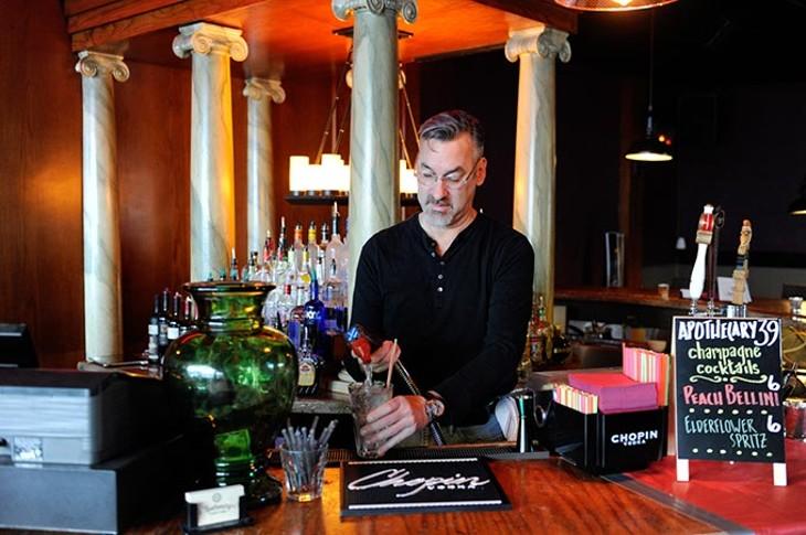 Bartender Philip Biggs makes drinks at Apothecary Thirty-Nine in Oklahoma City, Tuesday, Feb. 24, 2015. - GARETT FISBECK