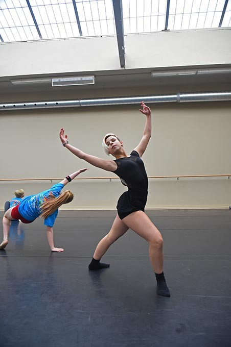 Freshman dance student Izzy Dillingham dances with new overhead skylighting in a Modern Dance class that once was a swimming pool, at Harding Fine Arts Academy, 9-28-2015. - MARK HANCOCK