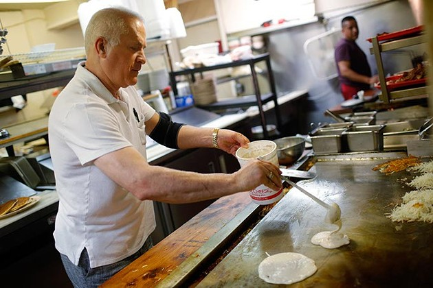 Jeff Ghandnoosh cooks pancakes at Jeff's Country Cafe in Oklahoma City, Friday, June 26, 2015. - GARETT FISBECK