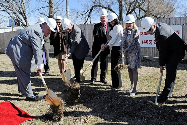 Dignitaries break ground during a groundbreaking ceremony at the Jesus House in Oklahoma City, Friday, Feb. 13, 2015. - GARETT FISBECK