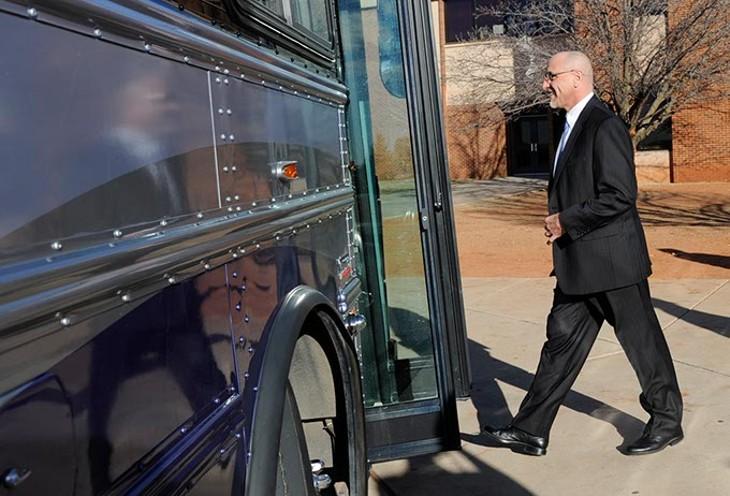 Oklahoma City Superintendent Rob Neu gets on a bus at Centennial High School in Oklahoma City, Wednesday, Jan. 28, 2015.  Legislators were given tours of F schools in the Oklahoma City public school system. - GARETT FISBECK