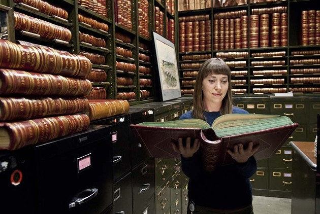 Jennifer Day is the City of Oklahoma City archivist, working in the City Clerk's office and in this vault storage room.  mh