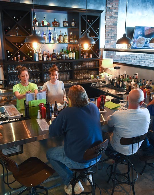 The Fixx has a full bar, so you can have your burger and drink it too, in Edmond, 11-17-15. - MARK HANCOCK