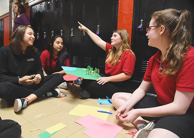 Students of Anna Kinder work on a Freshman English class project, in the hallway at Harding Fine Arts Academy, 9-28-15. - MARK HANCOCK