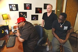 """Lamar """"L-Smooth"""" Mensa, right, listens to new tracks he has recently recorded with his producer, CAP, left, and good friend and manager, Rodney Dawson at Inferno Factory .  mh"""