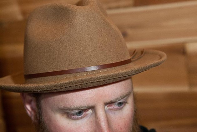Headware like this hat, modeled by Hunter Goodman will be featured at Trade Men's Wares. - MARK HANCOCK
