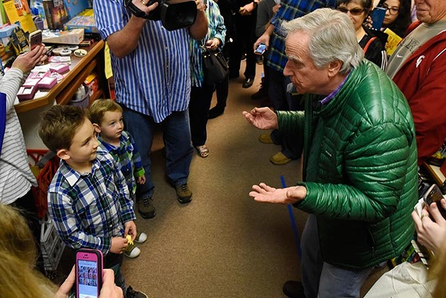 Henry Winkler does a magic trick for Owen and Henry Armstong, 6 and 2, at Best of Books in Edmond, Thursday, March 17, 2016. - GARETT FISBECK