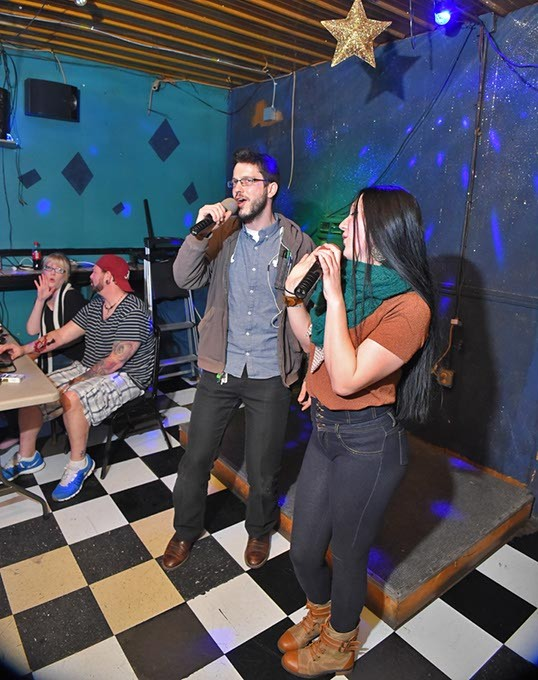 Chris Aaron and Tara Samules run their Pro Sound Karaoke, nights at Cookies, and that's Dillon Dakota Carroll and Robin FriedRich giving what they have on a recent Thursday night, 2-11-16. - MARK HANCOCK