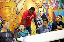 Sgt. T.G. Childs listens to members the FACT program during a lesson at Hathaway Recreation Center in Oklahoma City, Tuesday, Sept. 15, 2015. - GARETT FISBECK