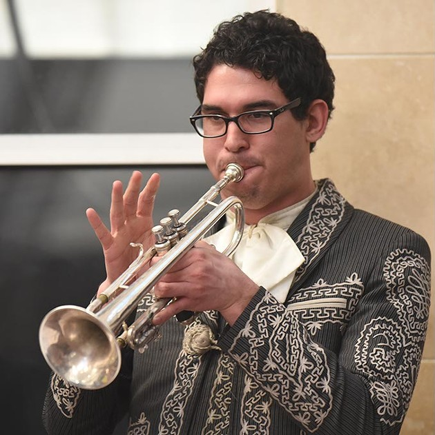 A trumpeter in the Mariachi Orgullo de America band performing at Plaza Major at the Crossroads recently.  mh