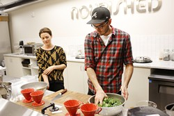 Lindsey Riddle and Jamie Conway prep kale at Nourished Food Co. in Oklahoma City. (Garett Fisbeck)