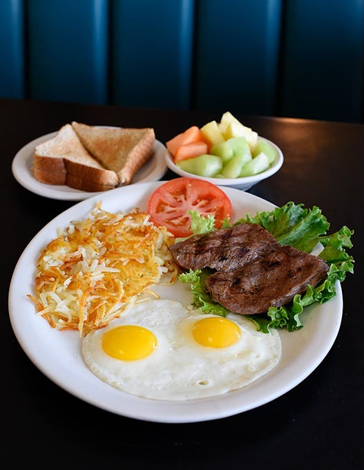Two egg breakfast with steak at Neighbor's Cafe, Wednesday, March 9, 2016. - GARETT FISBECK