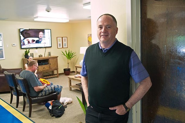 Mental Health Association Oklahoma Executive Director, Michael Brose, near the liveing room inside the OKC Drop in Center.  mh