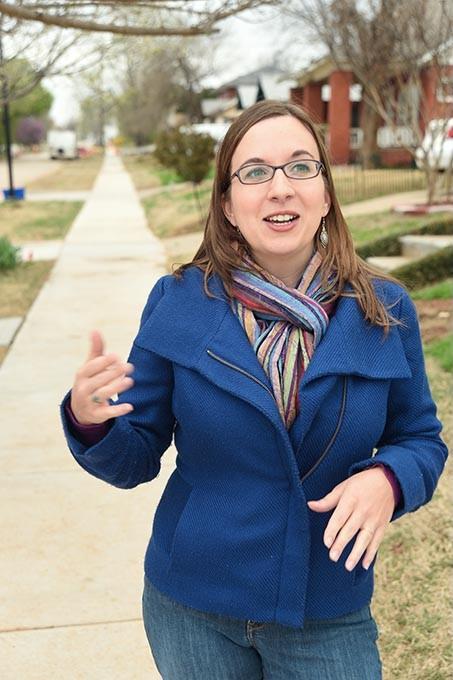 Classen's North Highland Park Neighborhood leader, Liz Stevens, on recently constructed sidewalks.  mh