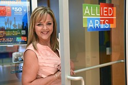 Deborah McAuliffe Senner is Allied Arts' President and CEO, outside their office door in the Cardinal Engineering Building in Auto Alley.  mh