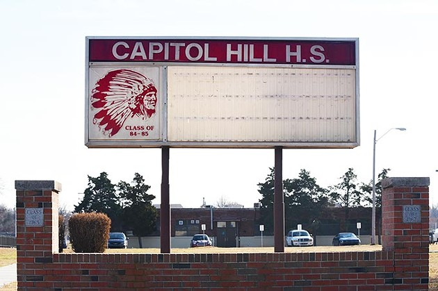 This Capitol Hill High School marquee with the Redskins artwork stands in the corner of the front lawn of the high school located at 500 SW 36th Street.  mh