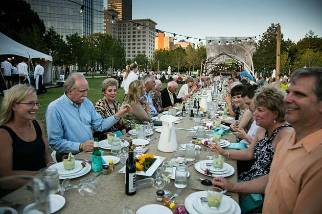 Guests enjoy a beautiful view and meal on the Myriad Botanical Gardens lawn