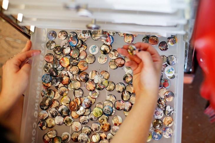 Peyton Bighorse of Skating Polly looks at buttons at Dig It! in Oklahoma City. (Garett Fisbeck)