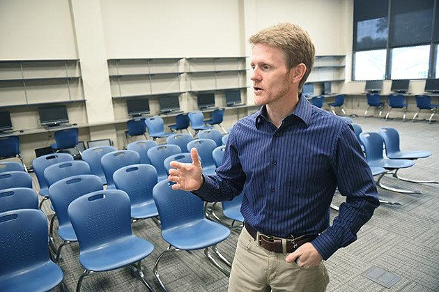 Principal Barry Schmelzenbach in a new Media Center at Harding Fine Arts Academy, 9-28-15. - MARK HANCOCK