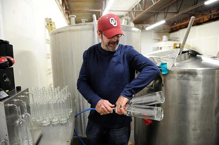Jeff Thurmon gives a tour of Success Vodka, showing the bottling process, in Moore, Thursday, Feb. 5, 2015. - GARETT FISBECK