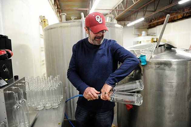 Jeff Thurmon gives a tour of Success Vodka, showing the bottling process, in Moore, Thursday, Feb. 5, 2015. - GARETT FISBECK