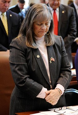 Rep. Sally Kern prays during Gov. Mary Fallin's State of the State address at the Oklahoma State Capitol in Oklahoma City, Monday, Feb. 2, 2015. - GARETT FISBECK