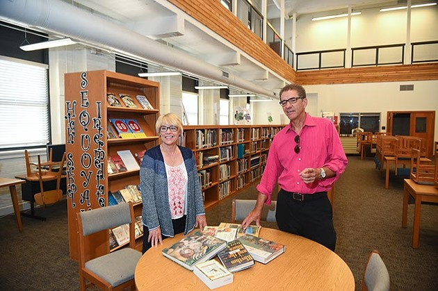 Kathleen and Roger Lienke in the library at Classen SAS recently.  mh