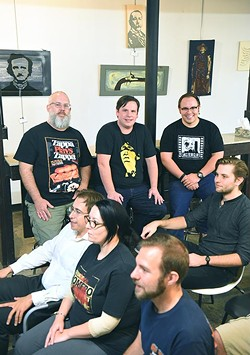 From left, OKC Film Club organizers, Patrick Crain, Eric King, and Alex Palmer, in back with a crowd ready for the start of a horror film at District House in the Plaza District, 10-14-15. - MARK HANCOCK