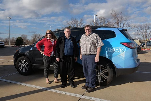 Lori Rasmussen, Nick Farlow, and Sidney Terry pose for a photo with the Embark Rideshare car in Edmond, Monday, Feb. 20, 2017. - GARETT FISBECK