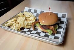 Aikman Bacon Avacado Burger with Waffle Fries at 1907 Burgers & Brews in Moore, Friday, Sept. 23, 2016. - GARETT FISBECK