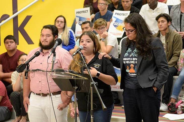 DACA recipients Alejandro Raigoza Munoz left and Judith Huerta right comfort Brisa Ledezma as she speaks during a demonstration to defend DACA at Santa Fe South High School last week. (Garett Fisbeck)