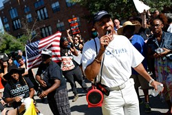 Garland Pruitt, president of the NAACP Oklahoma City branch, addresses a crowd during a Black Lives Matter demonstration in Oklahoma City, Sunday, July 10, 2016. - GARETT FISBECK