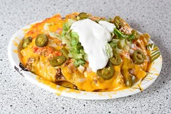 Nacho plate at Tacoville, Tuesday, April 26, 2016. - GARETT FISBECK