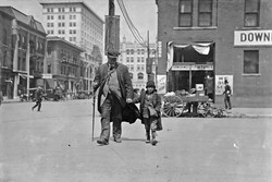Oklahoma City, Oklahoma - Lewis W. Hine - April, 1917 - Notebook Entry: Blind man and his youthful guide. - Library of Congress Prints and Photographs Division, Washington D.C. - LIBRARY OF CONGRESS