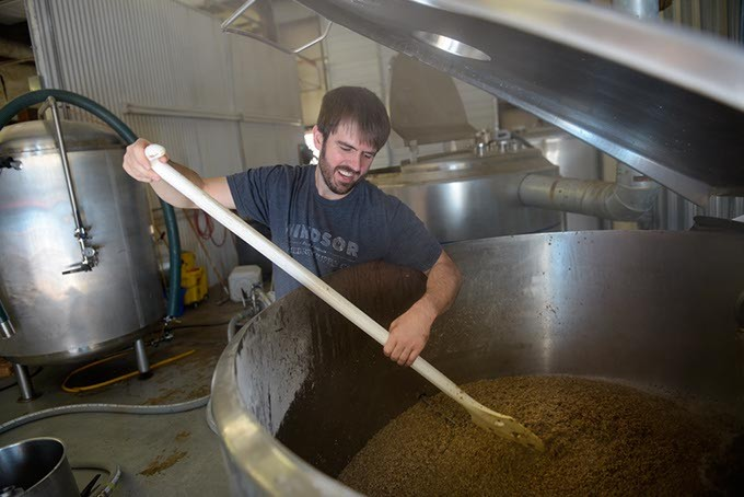 """Trae Carson works on a batch of new beer called """"Last Friday Night"""" at (405) Brewing Company in Norman, Tuesday, March 21, 2017. - GARETT FISBECK"""