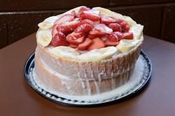 Strawberry-banana cake at Leo's BBQ, Monday, Dec. 5, 2016. - GARETT FISBECK