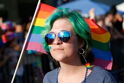 """Vaunda Knapp marches during the 2015 OKC Pride Parade. OKC Pride's theme for 2017 is """"30 years of resistance."""" The nonprofit organization is celebrating 30 years of Pride celebrations this year. - GARETT FISBECK / FILE"""
