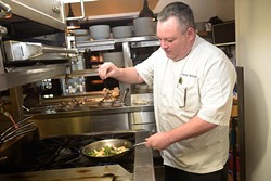Chef Patrick Williams cooks in the kitchen at Flint, Tuesday, May 30, 2017. - GARETT FISBECK