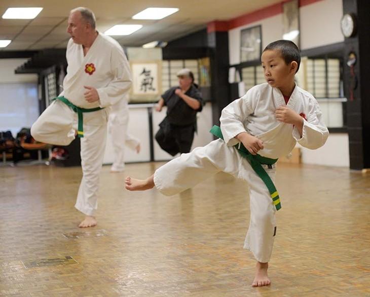 Ethan Nguyen, 7, and Robert Walker, 60, during a karate class at Okinawa Karate School, Thursday, Jan. 5, 2017. - GARETT FISBECK