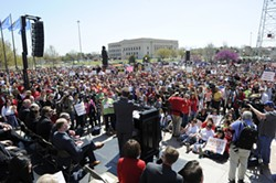 Thousands gather on at the Oklahoma State Capitol for a Teacher's Rally, Monday, March 30, 2015. - GARETT FISBECK