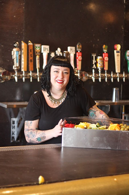 Pump Bar co-owner Hailey McDermid guards the fruit tray, which is not a snack bar for customers. (Greg Elwell)