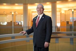 Tim Rogers, executive director of Metro Library System, poses for a photo at the Ron Norwick Downtown Library, Friday, Feb. 3, 2017. - GARETT FISBECK