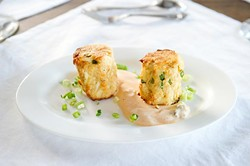 Lump crab cakes at Meat Market Refectory, Wednesday, July 6, 2016. - GARETT FISBECK