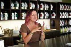 Urban Teahouse owner Kristy Jennings explains the brewing process. (Garett Fisbeck)